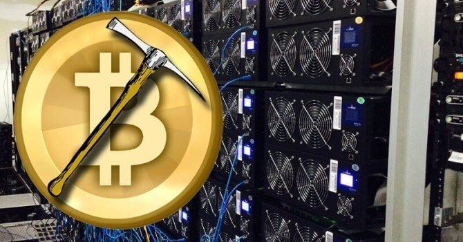 Na obrázku je zobrazen hardware a krumpáč na těžení Bitcoinu.